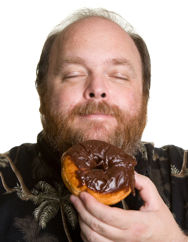 Man savoring moment before eating a donut