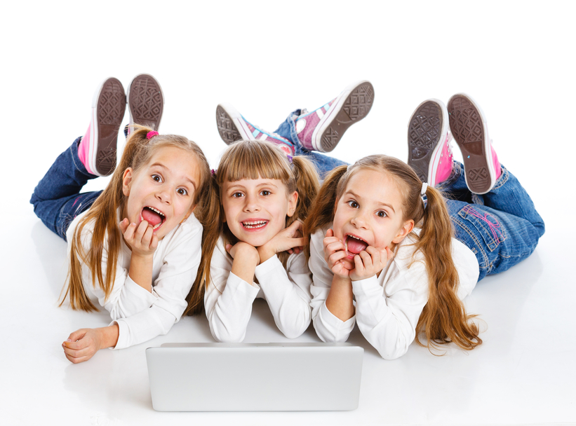 Three young girls using a laptop